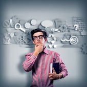 Young man scientist with glasses thinking — Stock Photo