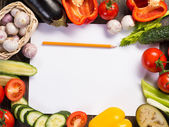 Vegetables tiled around a sheet of paper — Foto de Stock