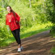 Healthy young female athlete running — Stock Photo #40205269