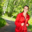 Healthy young female athlete running — Stock Photo #40205839