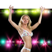 Young attractive woman in bikini holding banner — Stock Photo