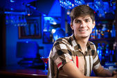 Portrait of a young man at the bar — Stockfoto