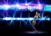 Woman in bikini and hat dancing — Stock Photo