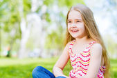 Portrait of a smiling girl in a park — Stok fotoğraf