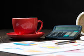 Calculator, business papers and a cup of coffee — Stock Photo
