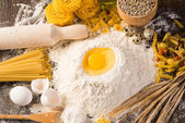 Flour, eggs, wheat still-life — Stock Photo