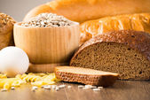 Fresh bread, eggs, pasta and grains — Stock Photo