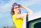 Young woman got out of car window — Foto Stock