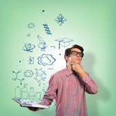 Young scientist holding a book — Foto de Stock