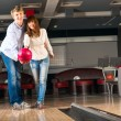 Постер, плакат: Young couple plays bowling