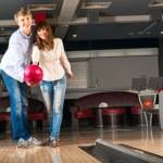Постер, плакат: Young couple plays bowling