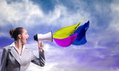 Business woman cooks shouting into a megaphone — Stockfoto