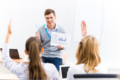 Teacher talking with students — Stock Photo