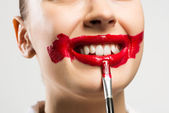 Close-up vivid red mouth — Stock Photo
