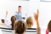 Female hand raised in class — Stock Photo