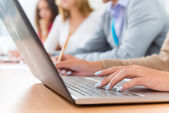 Close-up of female hands on the laptop keyboard — Stock Photo
