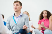 Group of young people meditating — Stock Photo