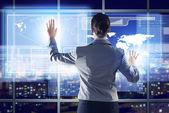 Businesswoman working with virtual technologies — Stockfoto