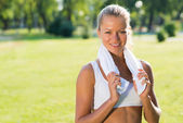 Attractive woman with a white towel — Stock Photo