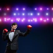 Businessman with boxing gloves in the ring — Стоковое фото