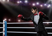 Businessman with boxing gloves in the ring — Foto Stock