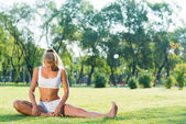 Woman doing yoga in the park — Stock Photo