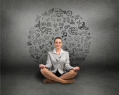 Business woman meditating — Stock Photo