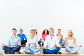 Young people meditating — Stock Photo