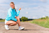 Young woman resting after jogging — Foto Stock