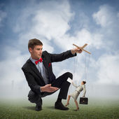 Puppeteer and business woman — Stock Photo