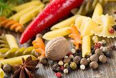 Chilli, herbs, Italian pasta and spices — Stock Photo