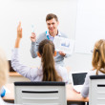 Teacher talking with students — Stock Photo