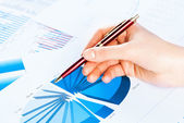Female hand pointing to the financial growth chart — Stock Photo