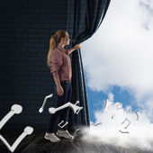 Young woman pushes the curtain looking at clouds — Stockfoto