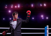 Businessman with boxing gloves in the ring — Stock Photo