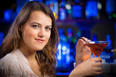 Young woman in a bar — Stock Photo