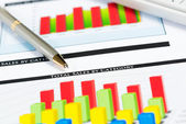 Close-up of pen and financial growth charts — Stock Photo