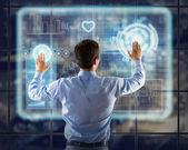 Businessman working with virtual technologies — 图库照片