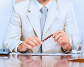 Businessman holding a pen in hand — Stock Photo