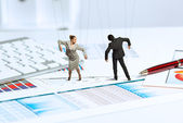 Business dolls puppets on the desk — Stock Photo
