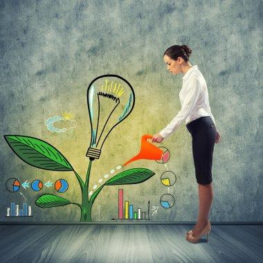 Businesswoman watering creative idea