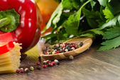 Colored pepper on wooden spoon — Stock Photo