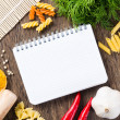 Spices and vegetables around notebook — Stock Photo #49324255