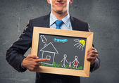 Businessman with frame — Stock Photo