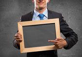 Businessman with frame — Fotografia Stock