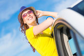 Young woman on car — Stock Photo