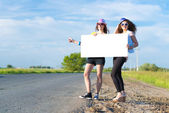 Two women with blank banner — Stock Photo