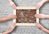 Hands holding frames — Stock Photo