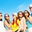 Group of young people wearing sunglasses and hat — Stock Photo #50704389