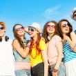 Group of young people wearing sunglasses and hat — Stock Photo #50706661